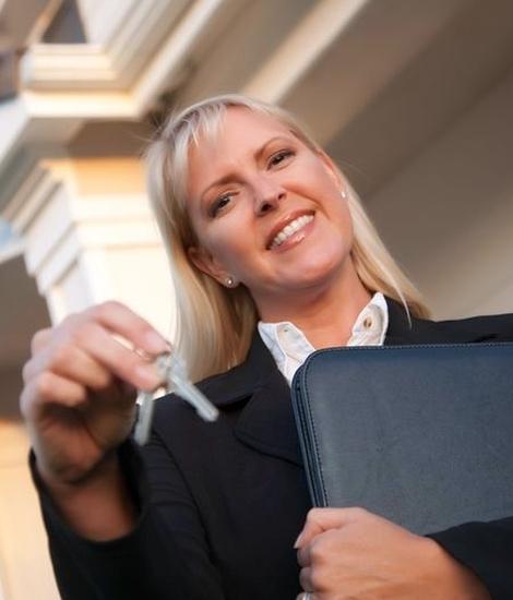 Orange County rental agency - agent giving keys to renters
