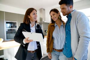 Real estate agent helping couple to find new home rental.